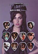 Amy Winehouse Guitar Picks On Photographic Background 10 Guitar Picks