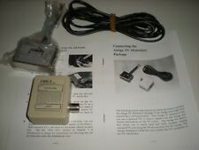 Amiga 1000 RF modulator. Connects Amiga 1000 to old televisions. With cable.