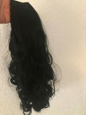 Black styled headband wig, one size fits all, new condition, original packaging
