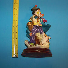 Clown Figure Playing Saxophone with Dog