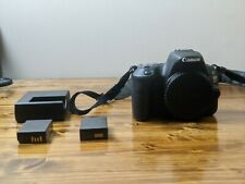 Canon EOS Rebel sl2 dslr camera with battery pack and two batteries