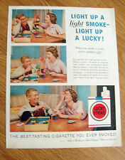 1957 Lucky Strike Ad Couple Playing a Game Stacking Blocks