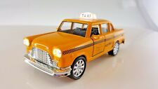 Yellow classic taxi with *Bright light & Sound* New York City Die Cast Metal car