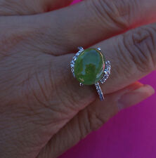 Large green stone 1/4ct H/VS/Si1 18k White gold ring