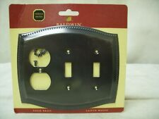 Baldwin Hardware - Double Toggle/Single Duplex Outlet Combination Switch Plate