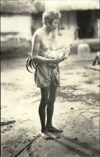 Indonesia? Older Semi-Nude Woman Holding Chicken in Street Real Photo Postcard
