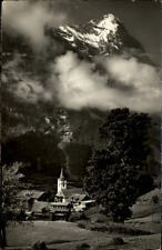 Grindelwald alte AK Schweiz AK 1953 gelaufen Blick auf die Kirche mit Eiger