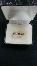 STERLING SILVER SIZE 8 RING WITH RED ACCENT STONE 2.5 GRAMS