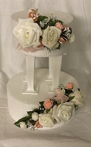 wedding flowers ivory & Peach roses & ribbons with  cake 2 tier topper