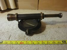 Vintage brass surveyor compass, level, spyglass. Extendable telescope sight.