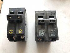 Two (2) 20 Amp 2-Pole 10kA Circuit Breakers, used