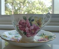 Queen Anne Fine Bone China Teacup and Saucer. Made in England  Red Yellow Floral