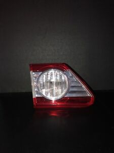 TOYOTA COROLLA 2011-2012 LEFT/DRIVER SIDE INNER DECKLID MOUNTED OEM TAIL LIGHT