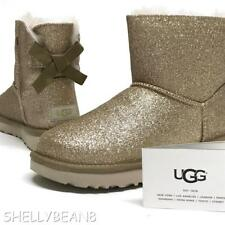 UGG Mini BAILEY BOW SPARKLE Boots GOLD Booties SHEARLING Fur LINED 11 NEW NIB