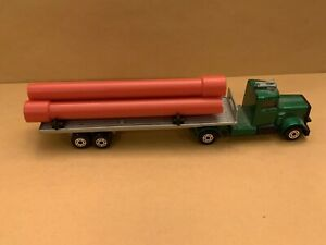 Matchbox 900 Series TP-25 Pipe Truck Green Cab Orange Pipes Silver Trailer
