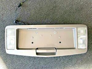 2004-2009 CADILLAC SRX REAR BACKUP LICENSE TRIM SURROUND PANEL LIGHT BRONZ OEM