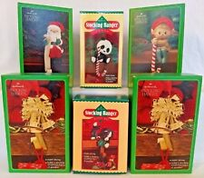 Set of 6 Hallmark Christmas stocking hangers – new, in boxes.
