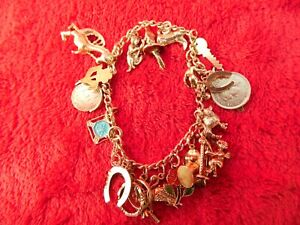 STERLING SILVER CHARM BRACELET WITH 20 CHARMS NESSIE PLAYING BAGPIPES ETC. BELOW