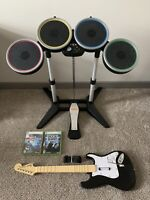 Xbox 360 Rock Band Bundle With Wireless Drums, Pedal, Wireless Guitar, & 2 Games