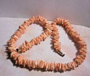 Pink conch shell one strand necklaceThe shell sliced into thin 5mm by 3mm.slices