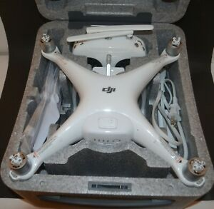 WORKING DJI PHANTOM 4 DRONE w/15 MEGAPIXEL CAMERA, REMOTE, CHARGER, BLADES,&CASE