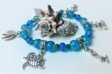 Ocean Sparkle Mermaid Stretch Charm Bracelet with Seven Charms and Glass Beads