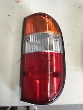 FORD COURIER PE TUB R/H TAIL LIGHT NEW NON GENUINE