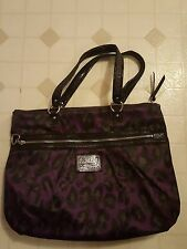 Coach purple and black poppy coach pocketbook.