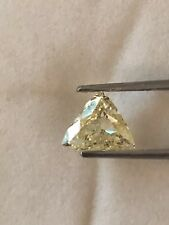 0.93 Cts. A LIGHT YELLOW TRILLION SHAPE DIAMOND. ALL NATURAL & EARTH MINED ONLY