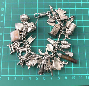 Vintage Solid Silver Charms Bracelet With 36 Charms Inc. Nuvo Chim