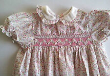 Girl's short sleeve Dress with pink smocking and small flower pattern 1980s Vint