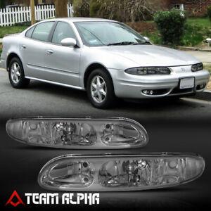 Fits 1999-2004 Oldsmobile Alero [Chrome/Smoke] Crystal Corner Headlight Headlamp
