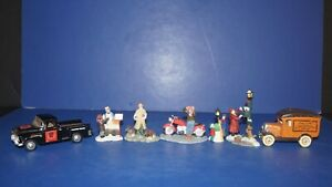 COLLECTIBLE LOT OF 7 CHRISTMAS VILLAGE TRUCK CYCLE PEOPLE FIGURINES ACCESSORIES