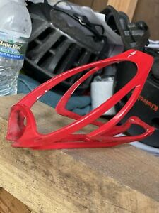 Red Specialized bottle cage — Light Plastic