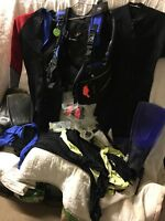 scuba gear lot includes flippers masks snorkles wet suits lycra suits bcd vest