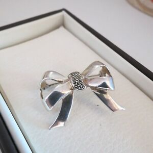 Modern style sterling silver & marcasite bow brooch