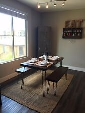 Reclaimed wood dining table plus two matching benches with hairpin legs
