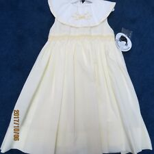 Sarah Louise girls dress size 4T, Light yellow smocking, new w/tags,collar white