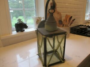 Antique exterior bubble glass porch light/lantern. Green rope.