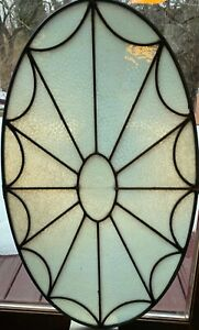 Small oval window stained glass window