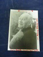 Vintage elderly Arvo Maki sweater seated smiles for Glossy Press Photo