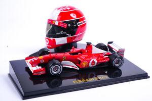 Modellino Casco Michael Schumacher Ferrari Scala 1:5 + Ferrari F2002 Scala 1:43