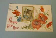 1911 Pretty Kitten Cat Happy New Year Embossed Holiday Postcard with Flowers