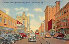 ST PETERSBURG FLORIDA~CENTRAL AVENUE-AUTOS-TROLLEY-STOREFRONTS~1940s POSTCARD