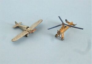 Two early Dinky Toys aircraft.