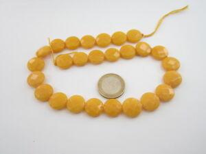 1 filo di agata giallo chiaro sfaccettata tonda/pastiglia diametro 15 mm.