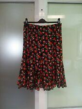 Jupe noire évasée à fleurs oranges Taille L