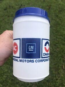 VINTAGE ADVERTISING GENERAL MOTOR GMC AC GM DELCO ALADDIN TRAVEL MUG CUP & LID