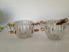 Jeannette glass ribbed sugar and creamer  with gold trim