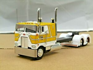 Dcp Custom stretched frame yellow/white Peterbilt 352 cabover tractor 1/64